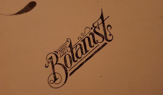 logo of The Botanist on a menu